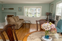 Living-Room_3-BR-House_Angle-from-table-with-flowers