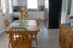 Long-Shot-of-Kitchen-Starting-at-End-of-Rectangular-Table_4-BR-House