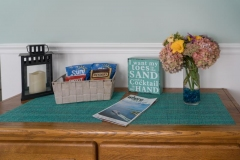 Welcome-Info-Area-with-Snacks_Flowers_Where-Mag